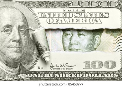 Torn hundred dollar bill with Mao from yuan