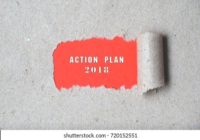 Torn paper with ACTION PLAN 2018 words. Business concept. Copyspace.