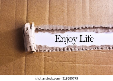 Torn paper box with word Enjoy life