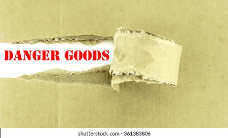 Torn paper box with words DANGER GOODS