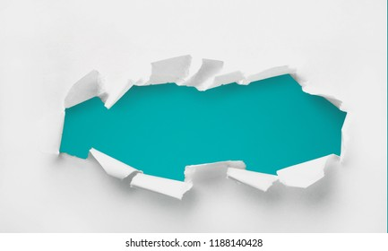 Torn paper with green hole