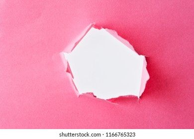 Torn paper with hole in center.