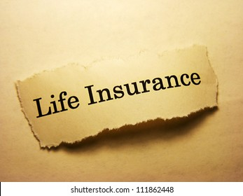 Torn paper with life insurance text. Life insurance concept.