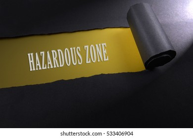 Torn paper with lighting render from right with word of hazardous zone . Occupational safety & health concept.