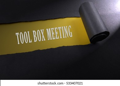 Torn paper with lighting render from right with word of tool box meeting . Occupational safety & health concept.