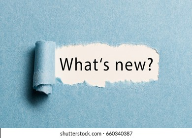 "torn paper revealing the phrase ""what's new?"""