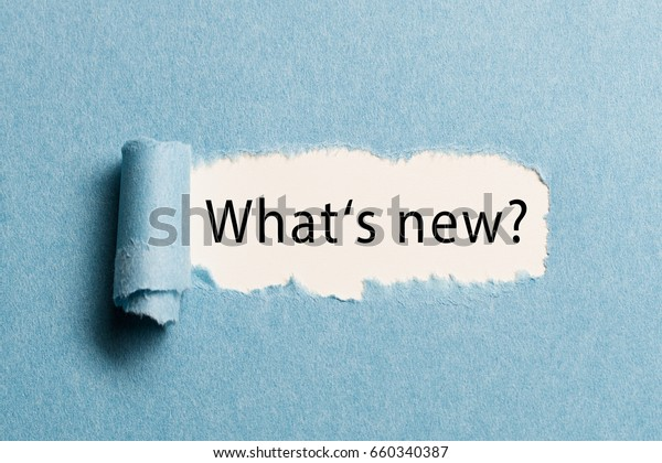 """torn paper revealing the phrase """"what's new?"""""""
