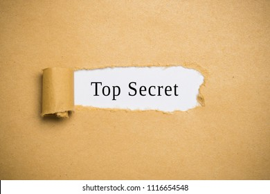"torn paper revealing the words ""Top Secret"""