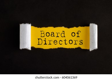 Torn paper with text BOARD OF DIRECTORS, business concept.
