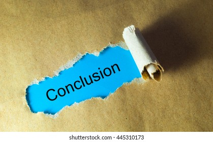 Torn paper with word conclusion