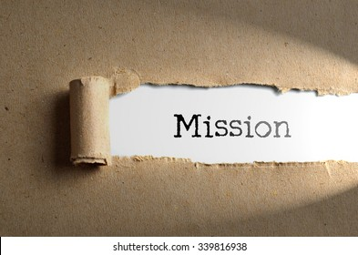 Torn paper with word Mission