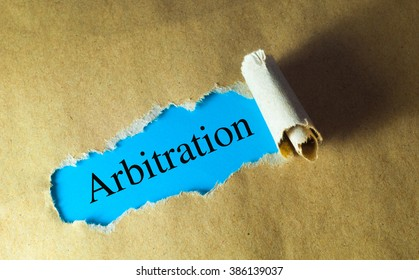 torn paper with word new arbitration