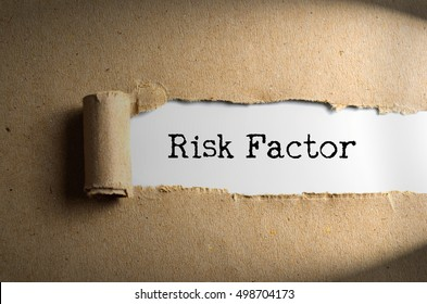 Torn paper with word RISK FACTOR. Conceptual Images