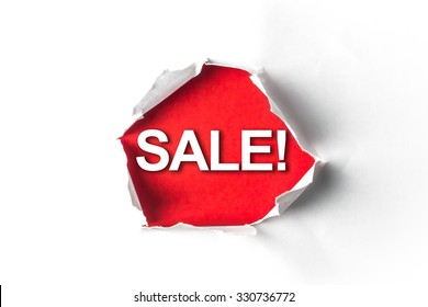 Torn paper with a word Sale!