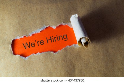 torn paper with word we're hiring
