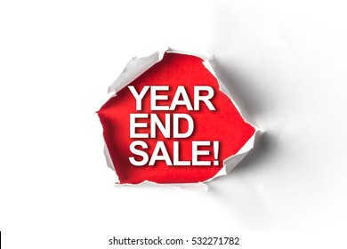 Torn paper with a word YEAR END SALE!