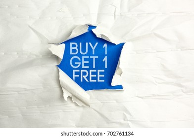 Torn paper writing Buy one get one free
