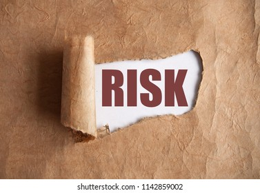 Torn piece of scroll uncovering risk