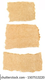 Torn pieces of brown cardboard paper on white background. Can be used for text.