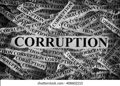 Torn pieces of paper with the word Corruption. Concept Image. Black and White. Closeup.