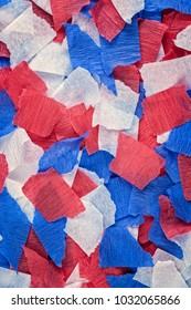 Torn pieces of red, white and blue crepe paper background