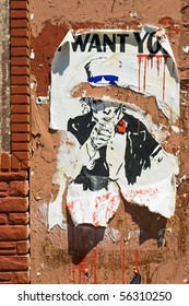 """A torn poster of Uncle Sam, """"I Want You"""" - makes an ironic statement about the government."""