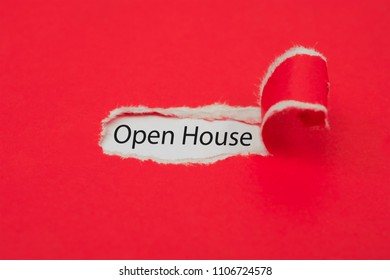 Torn red paper revealing the word of open house concept.
