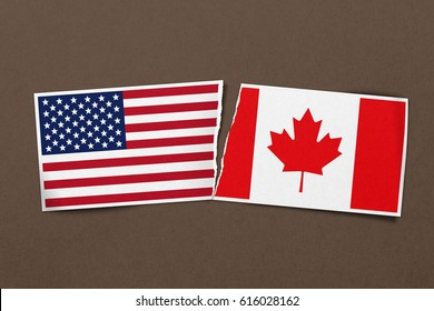 A torn relationship between USA and Canada shown on this paper design concept.