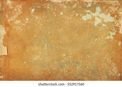 Torn shabby paper distressed background with paper and paint scraps