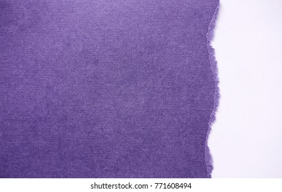 torn sheet of paper on a white background in colors of the year 2018 ultra violet pantone