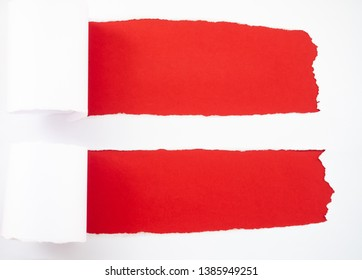 Torn white paper isolated on red