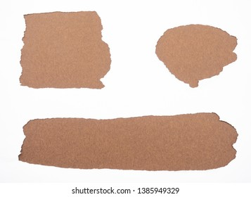Torn white paper isolated on brown