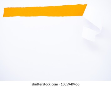 Torn white paper isolated on orange