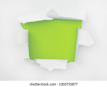 The torn white paper with an opening for a text or image insert