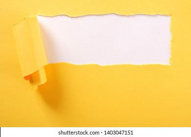 Torn yellow paper strip white background ripped