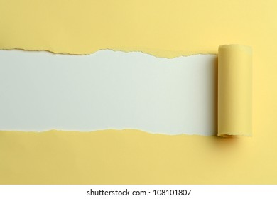 Torn Yellow paper with white on the background