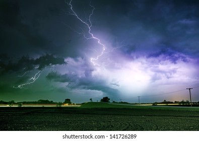 Tornado Alley Severe Storm at Night Time. Severe Lightnings Above Farmlands in Illinois, USA. Severe Weather Photography Collection.