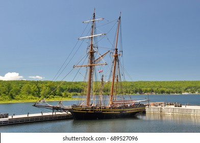 Tornoto, CANADA - July 12, 2013: Reconstruction of the armed British topsail schooner HMS Tecumseth at Discovery Harbour historical site in Penetanguishene, Ontario.
