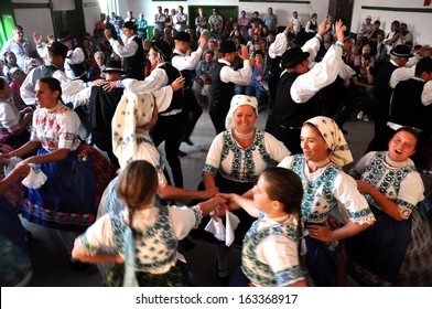 TOROCKO (RIMETEA) - AUG 30: Dancers in traditional Slovak clothes participate in the Hungarian folklore festival during the Rimetea Village Days. On August 30, 2013 in Torocko, Transylvania, Romania