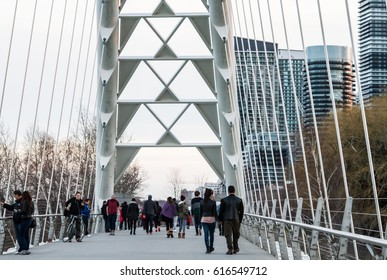 TORONTO - APRIL 1: People enjoying leisure walk at Humber Bay Bridge on a cool day early spring, Toronto, Canada, April 2, 2017
