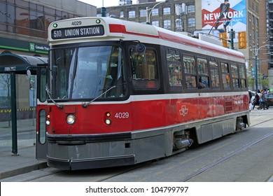TORONTO - APRIL 22: A Toronto streetcar on April 22, 2012 in Toronto. The Toronto Transit Commission (TTC) operates 11 streetcar lines and 248 streetcars.