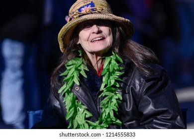 TORONTO - APRIL 28: An old supporter smiling with replica of marijuana leaves garland wrapped around her neck during the 420 Toronto 2018 event on  April 28 2018 in Toronto,Canada