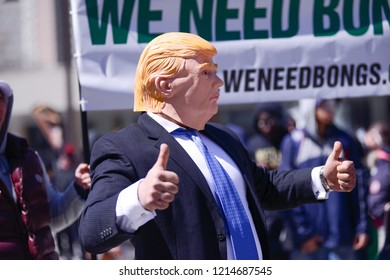 TORONTO - APRIL 28: A person wearing a Donal Trump mask during the 420 Toronto 2018 event on  April 28 2018 in Toronto,Canada