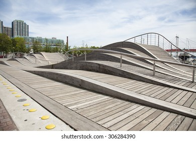 TORONTO - AUGUST 8, 2015: The Toronto Waterfront Wavedecks are a series of wooden structures constructed on the waterfront of Toronto, Canada as part of the revitalization of the central waterfront.