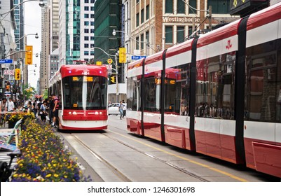 Toronto, Canada - 06 09 2018: A new Bombardier-made TTC streetcars on the King street in Toronto. Toronto Transit Commission is a public transport  agency that operates bus, streetcar and subway.
