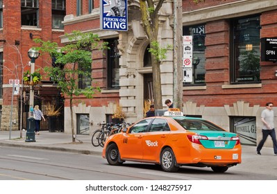 Toronto, Canada - 06 09 2018: Beck Taxi cab on King street in Toronto city. Founded in 1967 Beck Taxi has about 2000 cabs on GTA roads at any given time, 24 hours a day, 7 days a week, 365 days a year
