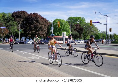 Toronto, Canada - 06 09 2019: Dedicated bicycle lanes in Toronto are in high demand by Torontonians. Riding a bike along the city makes it faster and more haealthy means of transportation.