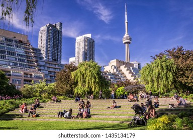 Toronto, Canada - 06 09 2019: Torontonians having rest in the Music Garden. Toronto Music Garden, one of the city's most enchanted locations, is inspired by Bach's First Suite for Unaccompanied Cello.