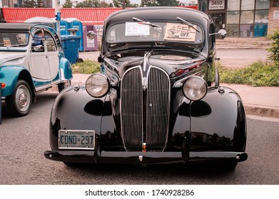 TORONTO, CANADA - 08 18 2018: Black 1937 Plymouth P4 Deluxe oldtimer car made by American automobile manufacturer Chrysler Corporation on display at the open air auto show Wheels on the Danforth.
