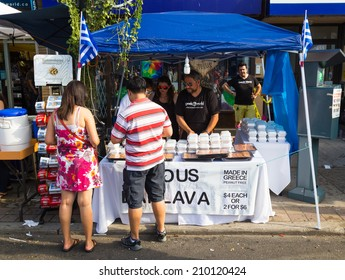 TORONTO, CANADA - 10 AUGUST 2014: A food stall during the Taste of Danforth Street Festival showing people serving and people browsing